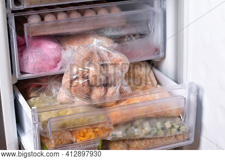 Semi-finished Products, Frozen Meatballs, Meat Patties In Plastic Bag In Refrigerator, Horizontal