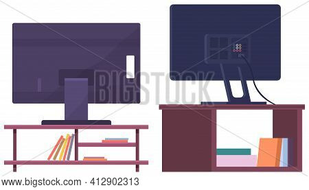 Plasma Tv On Table With Shelves, Open Drawers And Books. Big Screen Electronics For Watching Movies