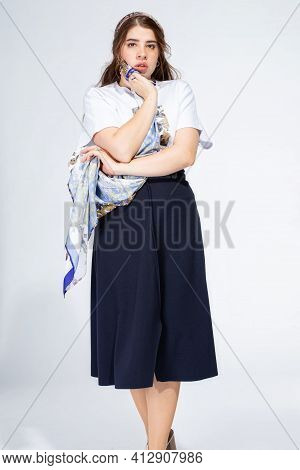 Worring White Young Woman Standing Isolated On Light Grey