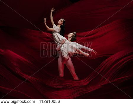 Love. Young And Graceful Ballet Dancers On Red Cloth Background In Classic Action. Art, Motion, Acti