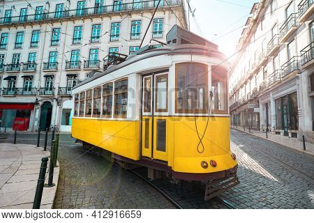 A Famous Yellow Tram On A Sunny Summer Day In Lisbon City Old Town, Portugal. Trams In Lisbon. Touri