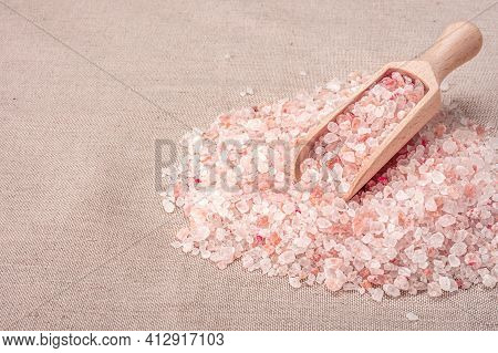 Pink Himalayan Salt. Wooden Scoop With Pink Himalayan Salt On Textile Burlap Background. Himalayan S