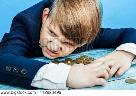 The Greedy And Greedy Child Covered The Coins With His Hands And Looks Around Angrily.
