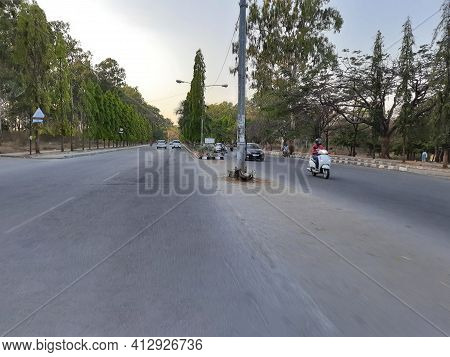 Closeup Of Beautiful Asphalt Roads Inside The Bangalore University With Motion Blur Background