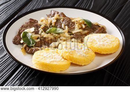 Venetian Style Calf Liver Fegato Alla Veneziana Closeup In The Plate On The Table. Horizontal