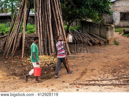 Zanzibar, Tanzania - January 2020: Black African People In Their Usual Lifestyle On Streets Of Zanzi