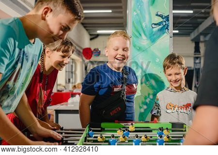 Dnepr, Ukraine- September 06, 2020: Happy Excited Young Boys Playing Table Football