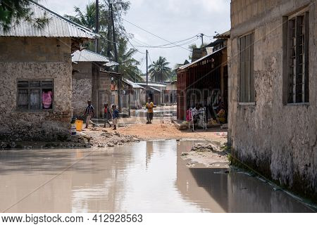 Zanzibar, Tanzania - January 2020: Black African People In Their Usual Lifestyle On Streets With Pad