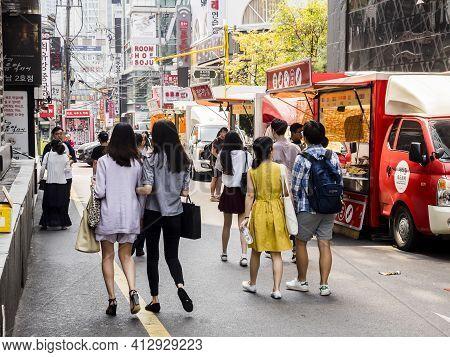 Seoul, South Korea - June 16, 2017: People Walking Down The Street In Seoul Downtown.