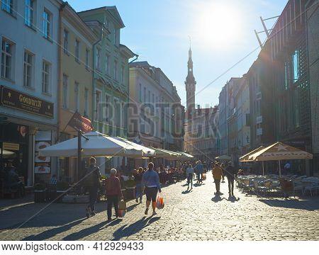 Tallinn, Estonia - July 14, 2019: People Walking By Sunny Street At Old Town Of Tallinn.