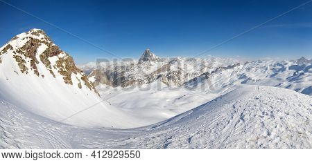 Monks Peak, named as Pic des Moines; in the center of the image you can see the Midi Ossau peak. Pyrenees, Aspe Valley in France.