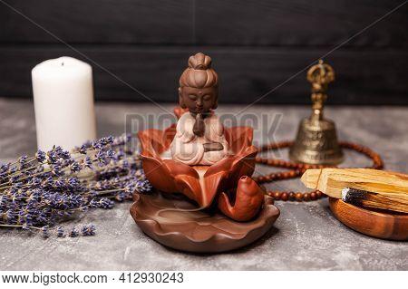 Aromatherapy, Spa Table Setting With Buddha. Buddha Meditation. Candle Incense. Calming Zen Interior