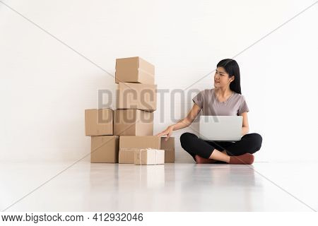 Young Asian Entrepreneur Feeling Stress And Anxiety Resulting From Reduced Sales After Checking Orde