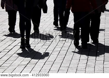 Silhouettes And Shadows Of People Walking On The City Street. Concept Of Society Or Population