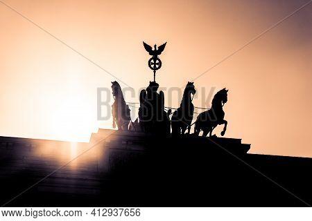 Brandenburg Gate Quadriga Sight In Berlin City Germany Europe. Sunset Behind The German Capital Symb