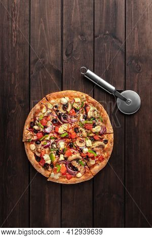 Whole Fresh Round Pizza With Chicken Meat, Vegetables, Mushrooms, Cheese And Knife Top View On A Woo