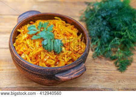 Braised Cabbage, Stewed With Tomato Sauce, Served In A Bowl On Wooden Table With Green Onion, Parsle