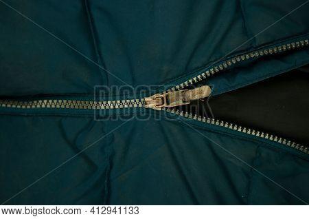 Detail of locking zipper on jacket. Close up macro local focus shot.