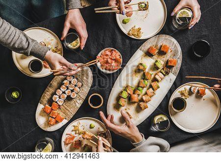 People Having Japanese Dinner During Lockdown At Home