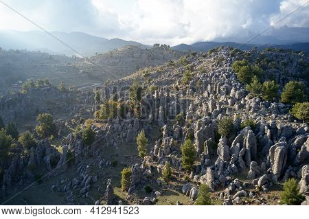 Breathtaking Landscape Of Rock Formations And Mountains.