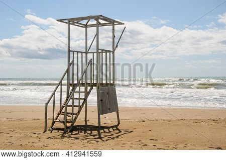 Empty Old Lifeguard Tower On The Beach On A Cloudy Day. Security On Public And Private Beaches.