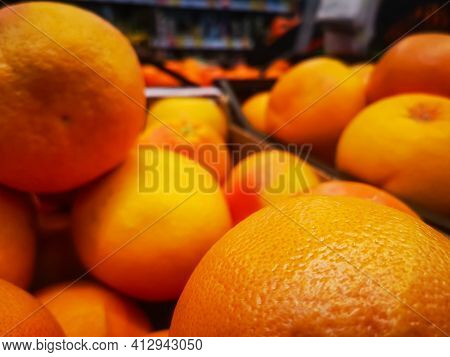 Juicy Large Oranges Close-up On Sale In A Grocery Supermarket.