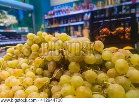 White Grapes Close-up On Sale In A Grocery Supermarket.