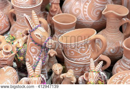Clay Cookware And Figurines In A Pottery Workshop.