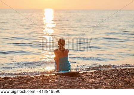 Lady Watching Lovely Sunset On Beach. Girl Rest In Calm Atmosphere. Idea Of Time To Relax And Vacati