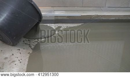 Leveled Dry Cement-sand Mixture On The Floor Surface In A Building Under Construction. Concrete Work