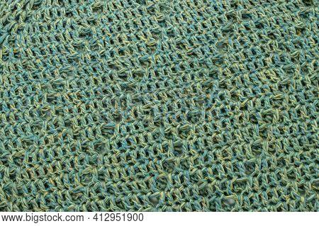 Crochet Thread Blue Green And Yellow Texture Background Closeup
