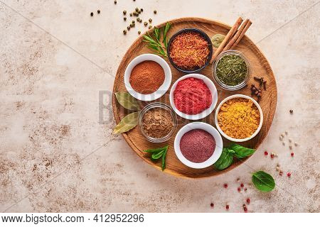Colorful Herbs And Spices For Cooking: Turmeric, Dill, Paprika, Cinnamon, Saffron, Basil And Rosemar