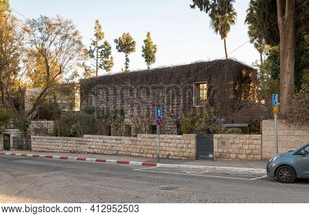 Jerusalem, Israel, February 27, 2021 : Evening View Of An Old Abandoned Building Overgrown With A Cu