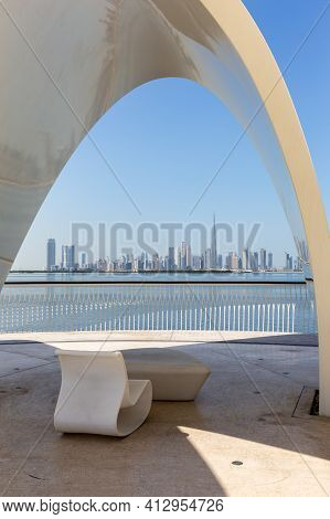 Dubai, Uae, 22.02.2021. Modern Style Chair With Sydney Opera House Roof On A Promenade Overlooking D