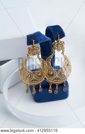 Vintage Earrings On White Background With Copy Space, Close-up