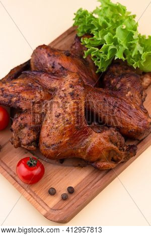 Grilled Chicken Wings On Wooden Board. Low-carb And High-fat Food. Menu For Carnivore Or Keto Diet