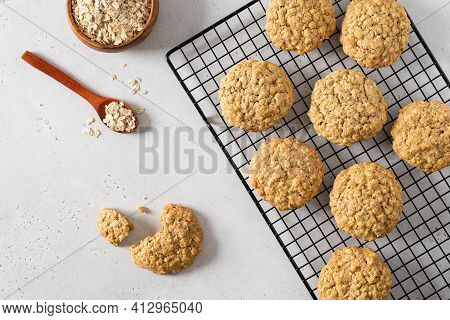 Homemade Oatmeal Cookies With Banana, Oats And Nuts On A Grid. Top View, Flat Lay. Healthy Food. Oat