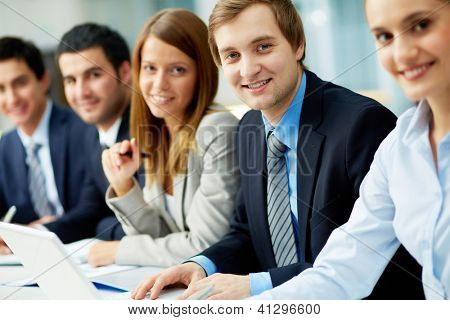 Business people sitting in a row and working