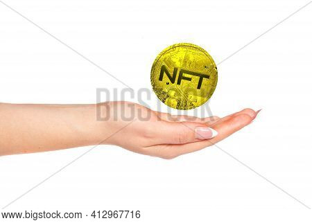 Female Hand And Stylized Three-dimensional Coin With The Inscription Nft. 3D Render