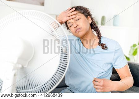 One Woman Suffering Summer Heatwave At Home
