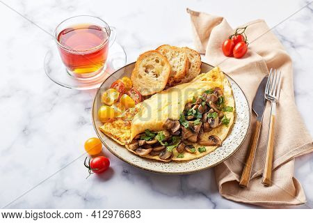 Omelet With Champignons And Parsley In Plate On Marble Background. Frittata - Italian Omelet