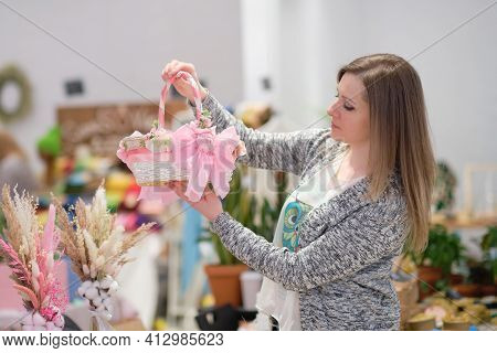 Business Owner Selling Behind Counter With Her Baskets For Wedding Or Easter At Local Market Of Craf