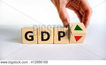 Gdp, Gross Domestic Product Symbol. Businessman Holds A Cube With Up And Down Icon. Word 'gdp'. Beau