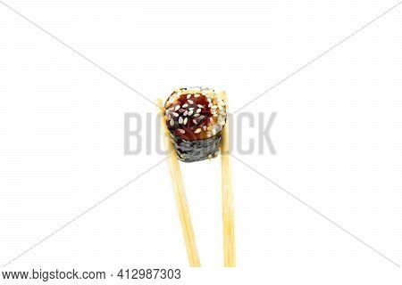 Take An Unagi Maki Rolls With Bamboo Chopsticks On White Background, Asian Food, Japanese Cuisine