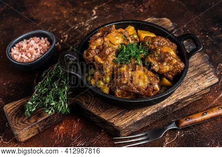 Beef Oxtails Stew With Wine And Vegetables In A Pan. Dark Background. Top View