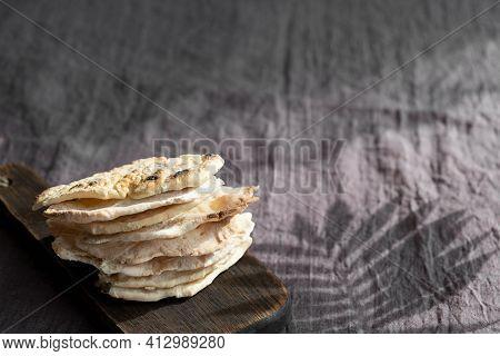 Homemade Matzo  With Microgreen Peas. Unleavened Flatbread Bread. Pesah Celebration Concept.  Jewish
