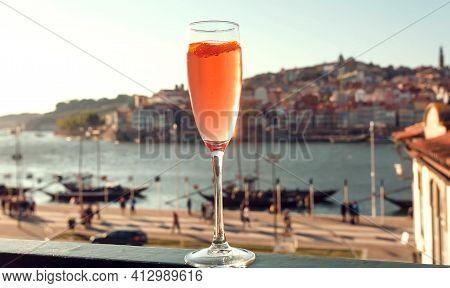 Wine In Glass On Window Sill With Cityscape Of Porto, Portugal. Cityscape With River Douro And Histo