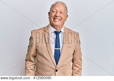 Senior caucasian man wearing business suit with a happy and cool smile on face. lucky person.