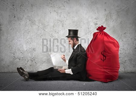 very rich businessman with big sack of money behind his back