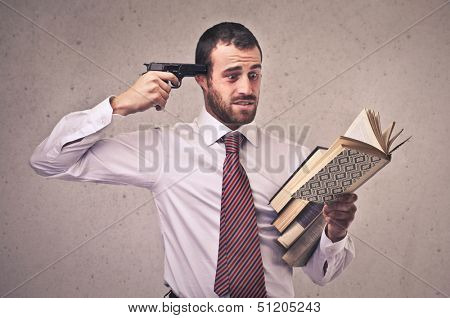 businessman with gun to his head while reading a book